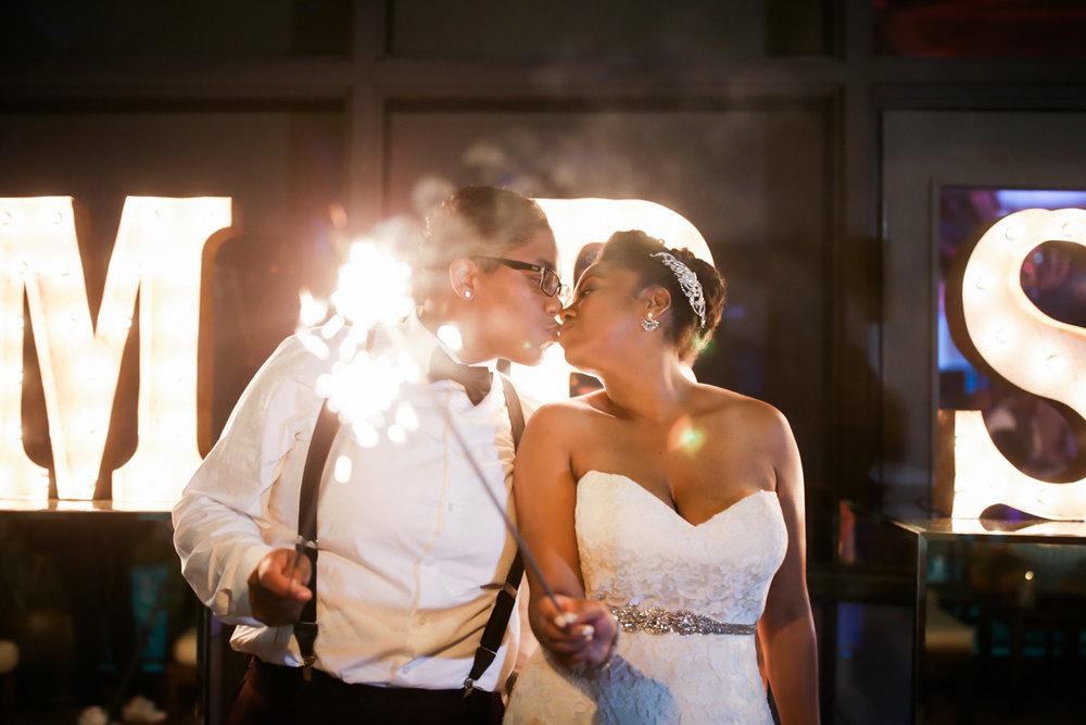 los altos lutheran same-sex wedding kiss while holding sparklers