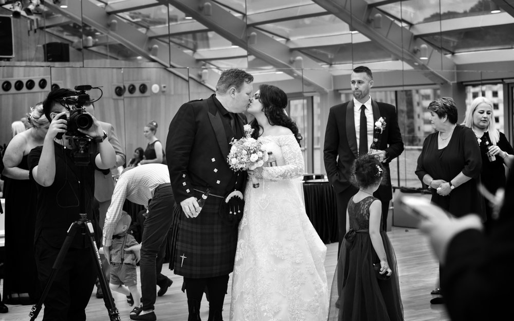 Mita and James sharing a kiss at their western wedding ceremony in hong kong