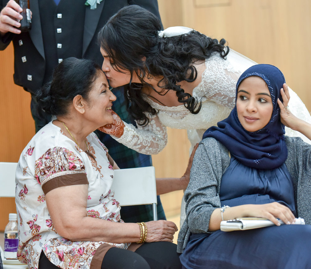 Mita giving her mom a kiss on the forehead at her western wedding ceremony in hong kong