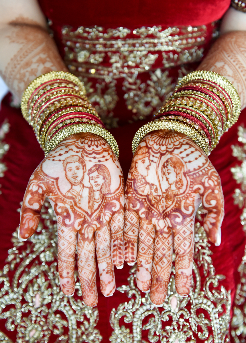 Mita showing off her henna that includes images of her and James at both their ceremonies