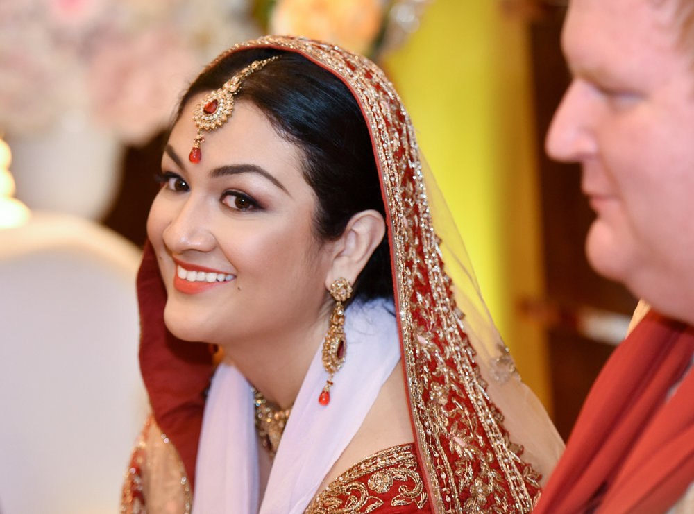 Mita smiling wide during their Indian wedding ceremony in Hong Kong