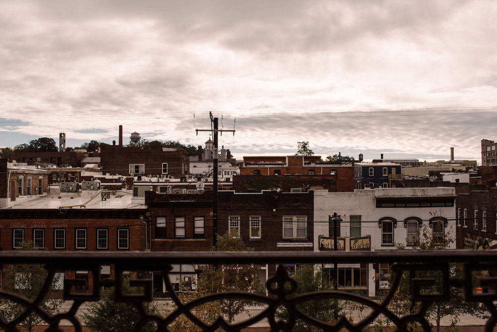 intimate wedding richmond virginia city buildings and overcast sky from balcony