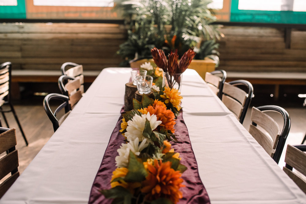 intimate wedding richmond virginia table with floral and small log centerpieces
