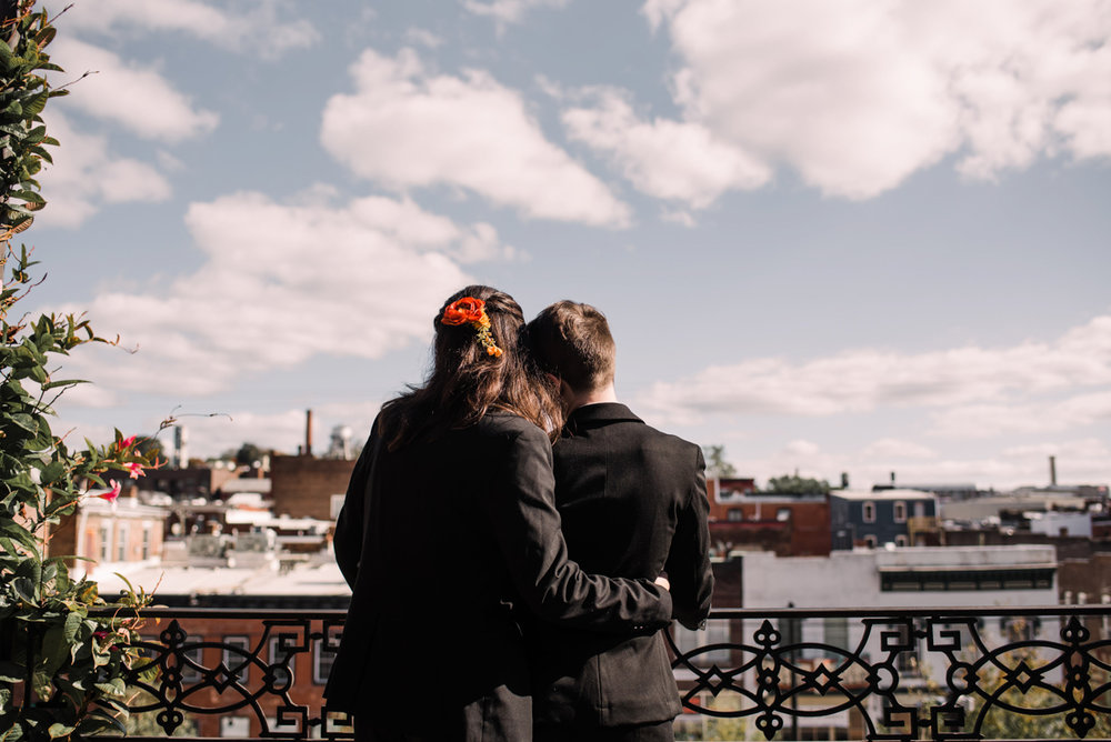 intimate wedding richmond virginia couple on balcony overlooking city