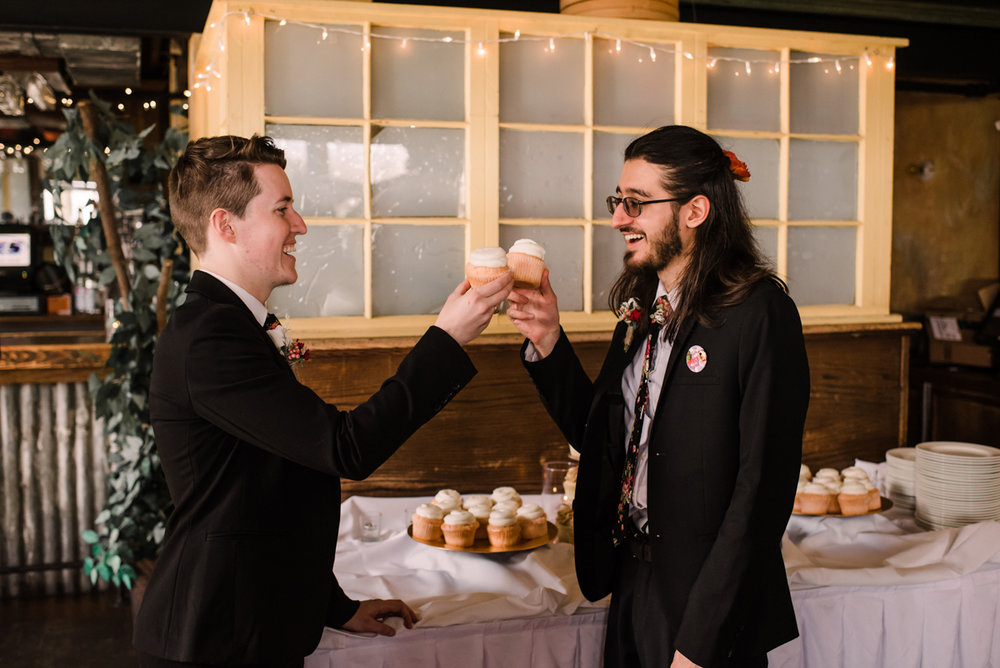 intimate wedding richmond virginia couple toasting with cupcakes