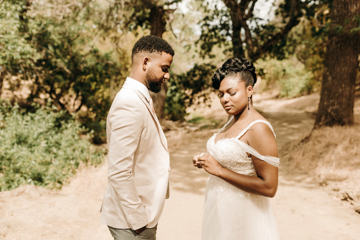 black bride and groom standing on path after wedding