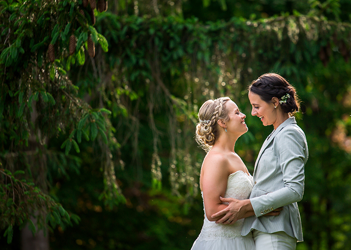 newlywed couple embracing after wedding