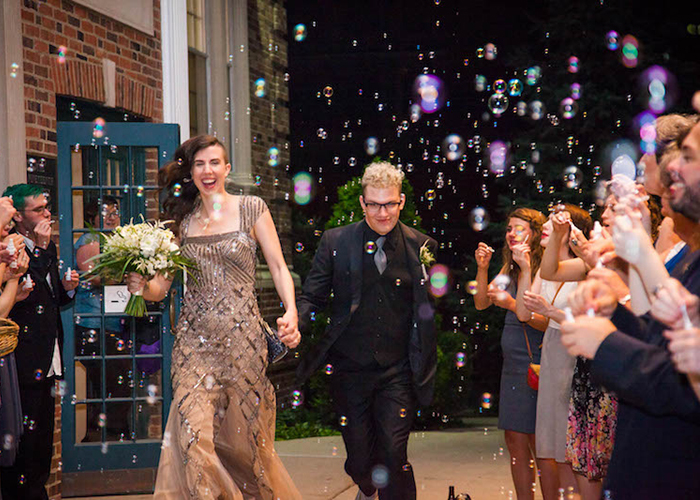 newlywed couple surrounded by guests and bubble exit St. Louis Missour