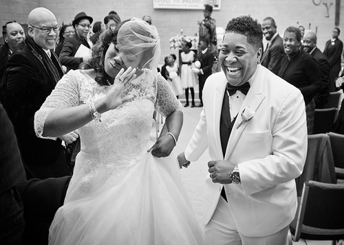newlywed couple dancing down the aisle after their wedding maryland
