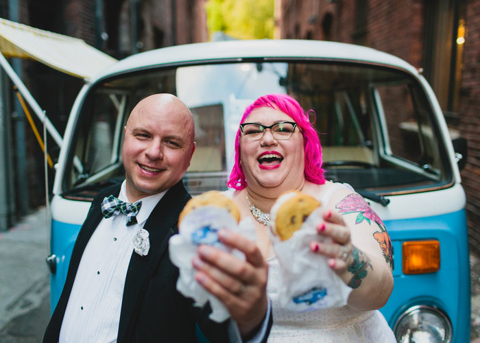 couples holding up donuts at wedding reception seattle washington