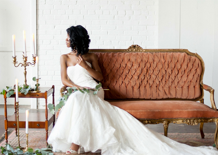 bride sitting on vintage couch at paisley and jade richmond va