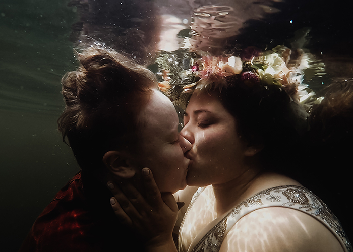newlywed couple kissing underwater