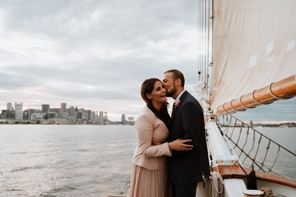 newlywed couple smiling after their wedding on a sailboat portland oregon
