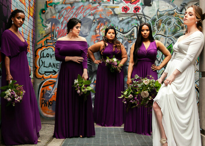bride and bridesmaids wear Henkaa wedding dresses in alley surrounded by graffiti Toronto