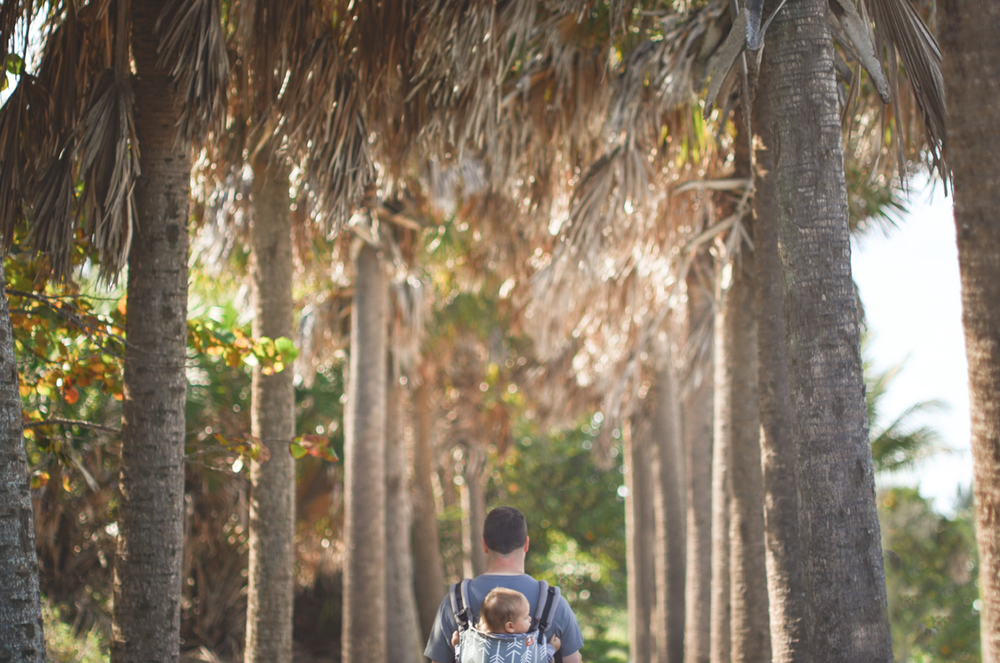 Babywearing among the palm trees.