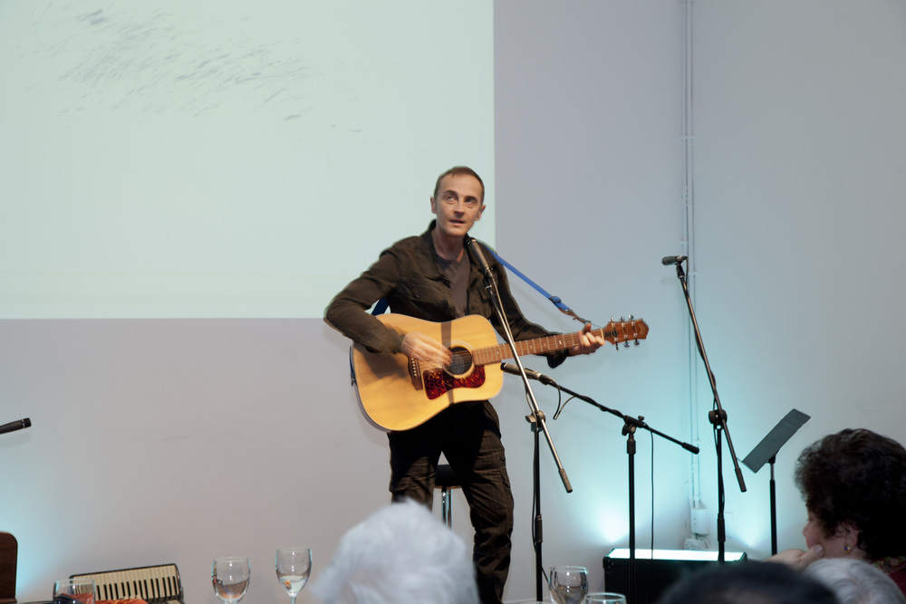 John Kelly performing a song