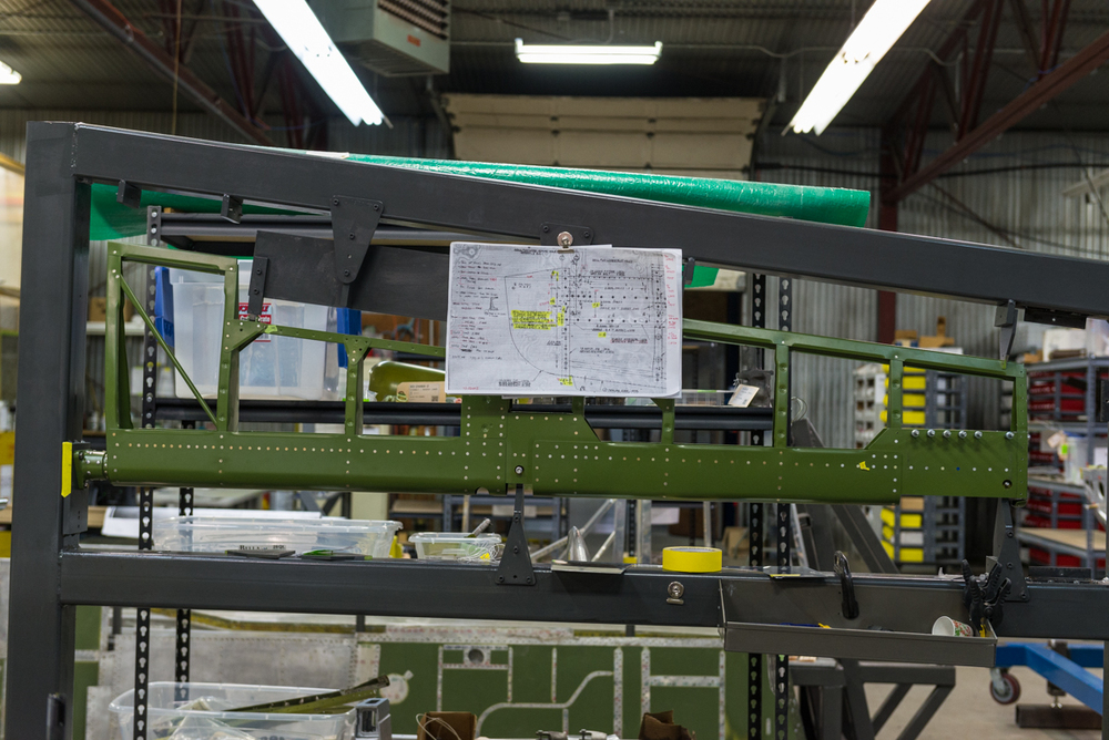 "Elevator in the jig, a good example of "" North American green"" , a darker green color of zinc chromate found on NAA airframes."