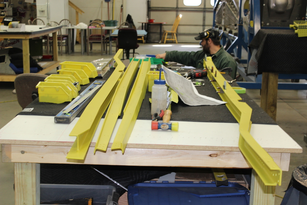 Yellow zinc chromate coated fuselage frame parts.