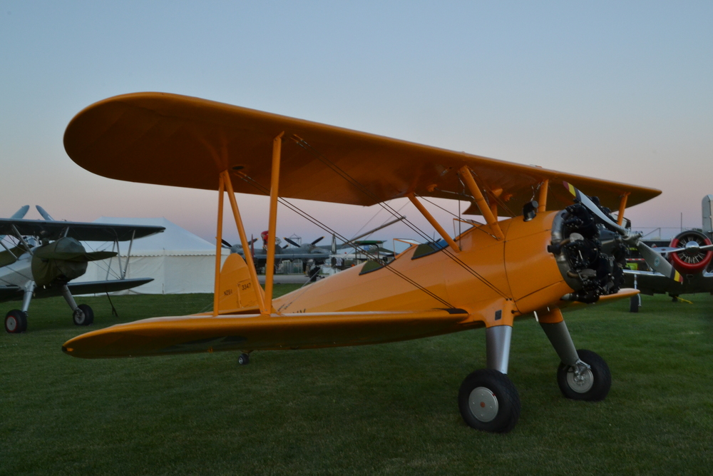 Twilight shot as BuAer 3347 sits in the trainer area at AirVenture 2015.   photo by our own Aaron Prince