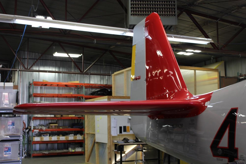 The signature red empennage, lacking only paint on the rudder. The whole airframe will be repainted in any case.