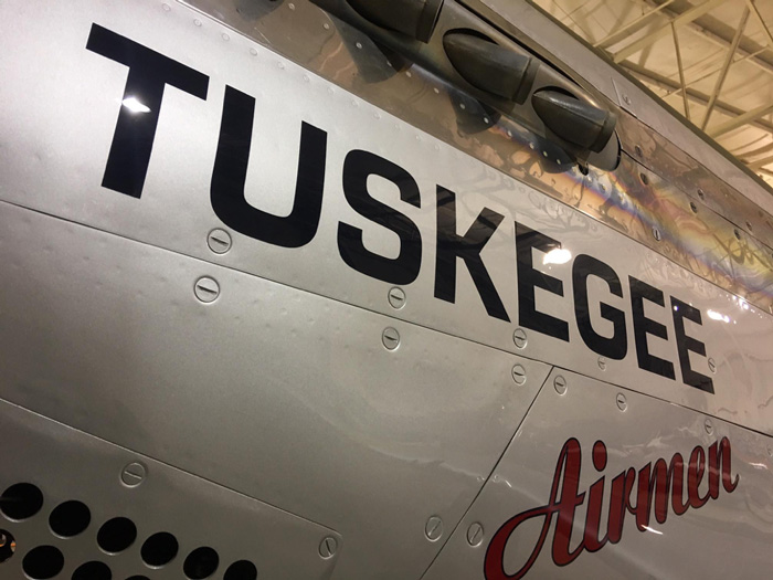 The Red Tail has nose art and markings that weren't from the factory, instead these iconic markings would have been applied while overseas.