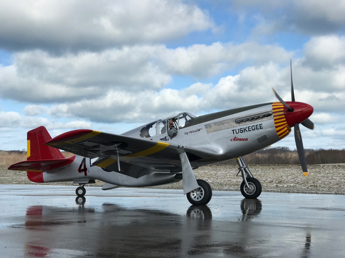 The P-51C is completely finished in this side view of the Red Tail in her new paint. ((Photo Credit: Adam Glowaski)