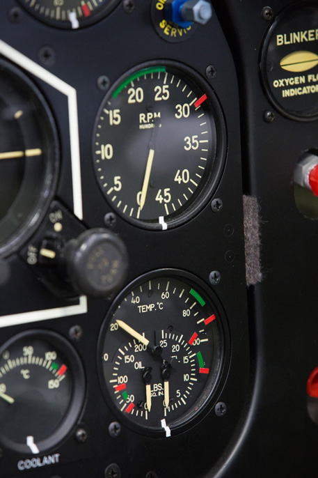 The upper gauge is the tachometer with the rpm redline and green normal operating range. The lower gauge is a three in one affair with oil temperature across the top and oil pressure on the bottom left, fuel pressure bottom right.