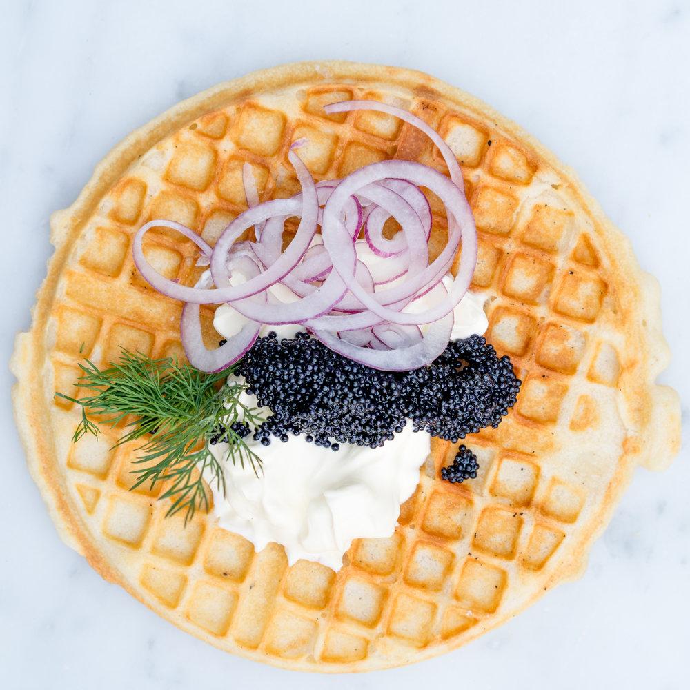 Sour cream, red onion & caviar