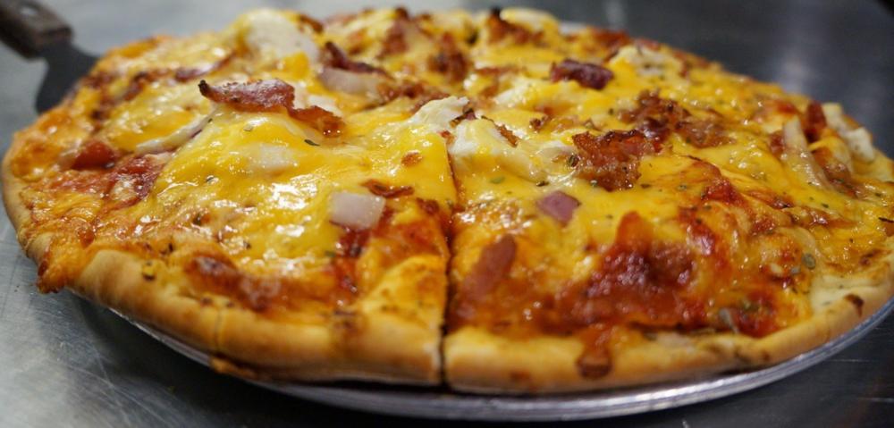 Cheese Louise - cheddar, ricotta, parmesan, mozzarella, smoked gouda, red onion & bacon.