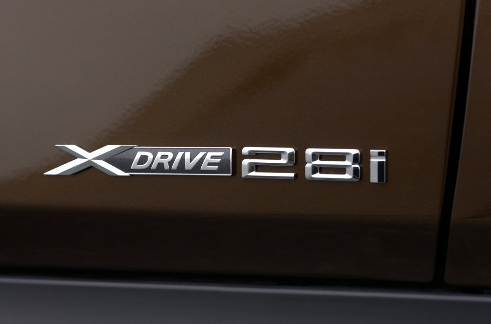 The badge above is from a BMW X1. Back in the 70s through the early 2000s, those two numbers would represent the engine displacement. However, the X1 does not have a 2.8-liter motor. It has a 2-liter motor. So what is this badge about? It's  an homage to the days when base BMW motors were 2.8 liters . Somehow BMW thought that this number would matter to longtime brand loyalists. I don't think it does.