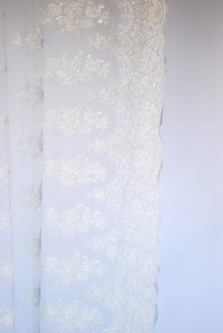 This stunning French Lace runner is the perfect luxurious topper for a Head Table. Complete with delicate silver beading to reflect the glow of candles this piece will make your table sparkle with sophistication.