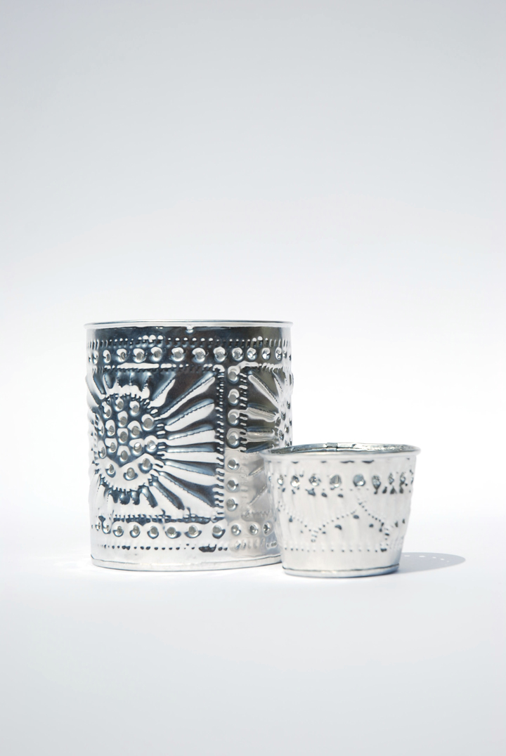 With the old world charm of an ornate tin ceiling these votives are perfect for incorporating silver accents into your table decor.
