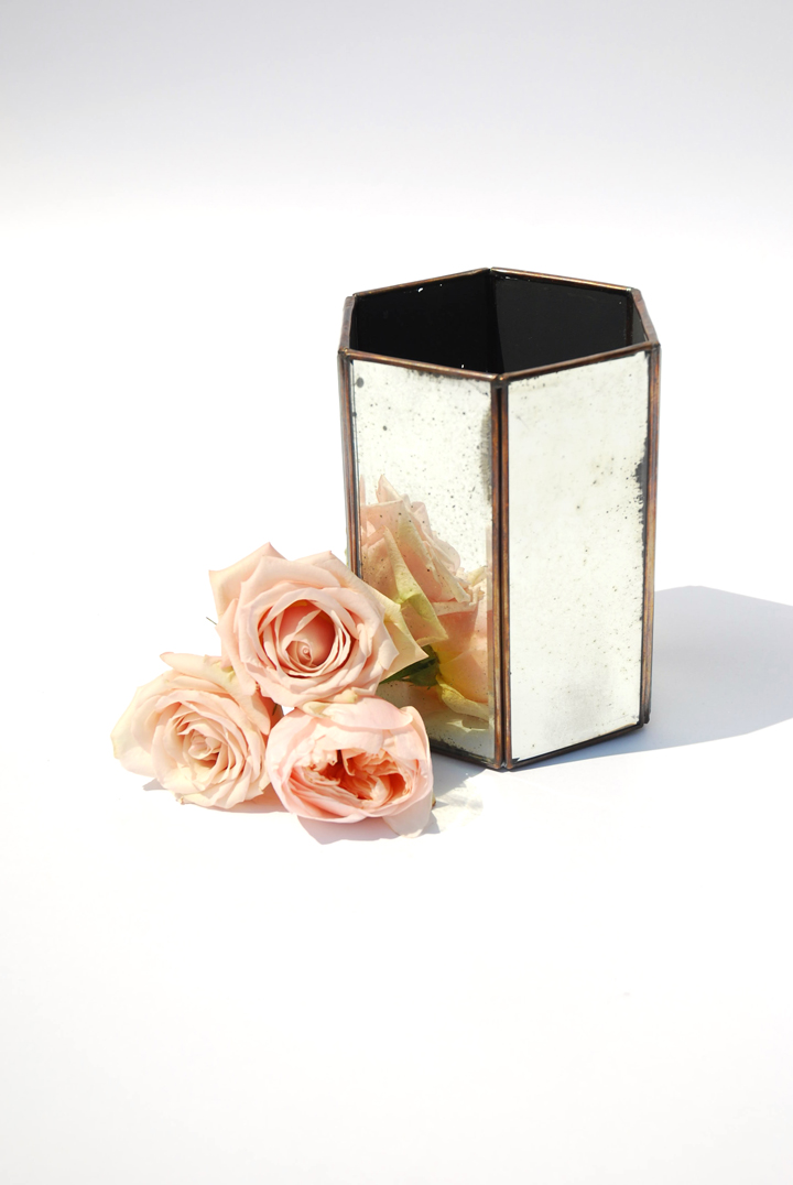 These hexagonal vases have a subtle antique quality to the mirrored panels. They offer a contemporary shape with a reflective romance.