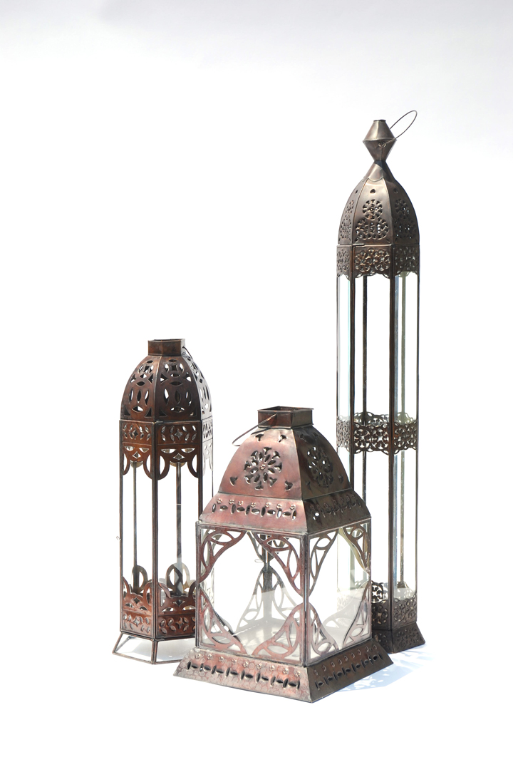 We offer an assortment of ornate lanterns with a dark drown metal finish and beveled glass. Dress them up with pillar candles nestled in a bed of rose petals or drape them in fresh blooms. These lanterns can be clustered to flank your alter or Head Table, used individually or in a row as centrepieces or they can be suspended for intimate lighting.
