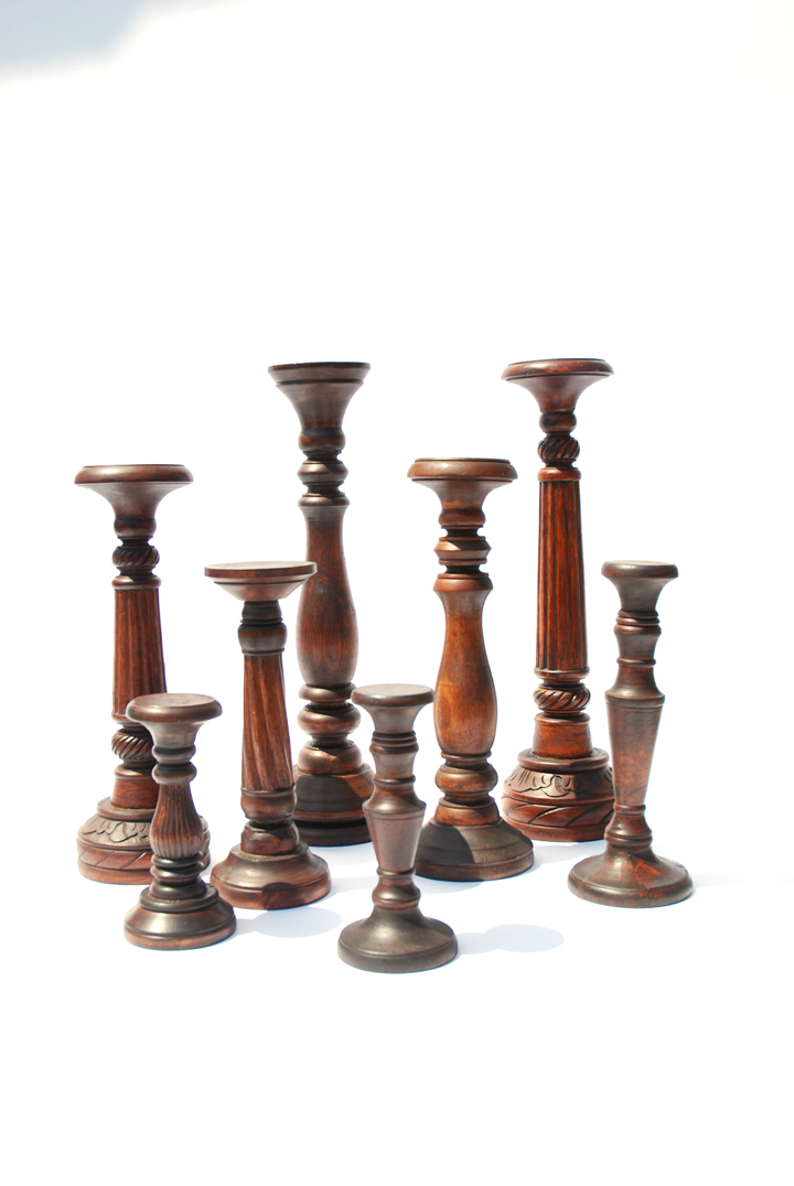 Hand-carved with a Mahogany finish these pillar candle holders are a handsome addition to the Redfern Collection. There is an assortment of complimentary styles in this collection which can be outfitted with glass candleholders to keep flames enclosed.