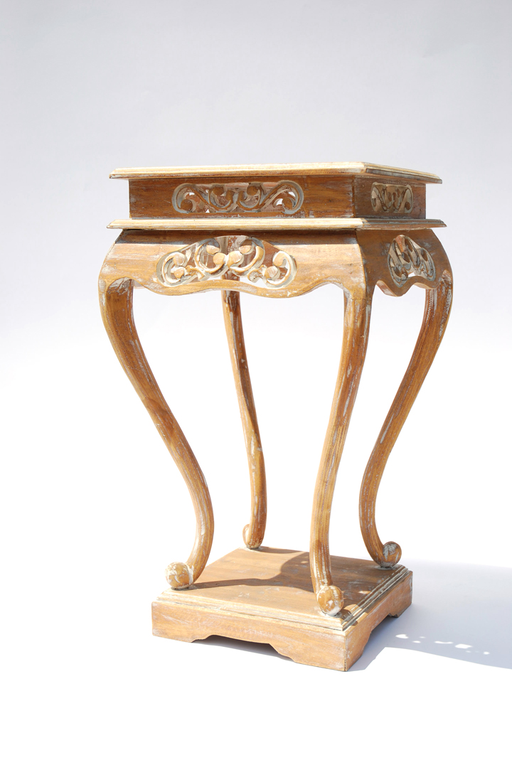 This pair of ornate side tables have hand-carved details with subtle white-washing to enhance the design. They compliment the Bizou Lounge collection or could be used as pedestals at the alter or flanking the head table.