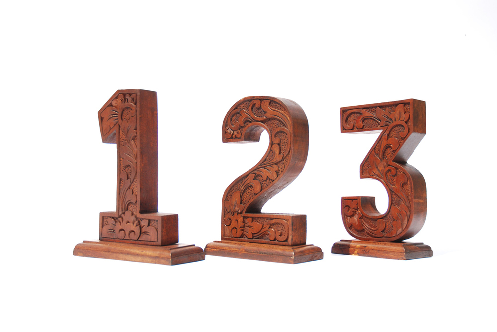 Our Redfern Collection Table Numbers are hand-carved with a Mahogany finish. They are free-standing and range from 1-15.