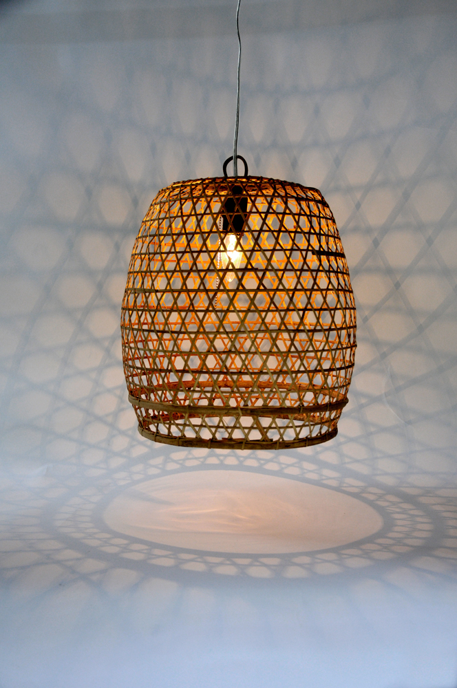 These bamboo basket pendants are hand-woven and add a beachy flair to outdoor parties.