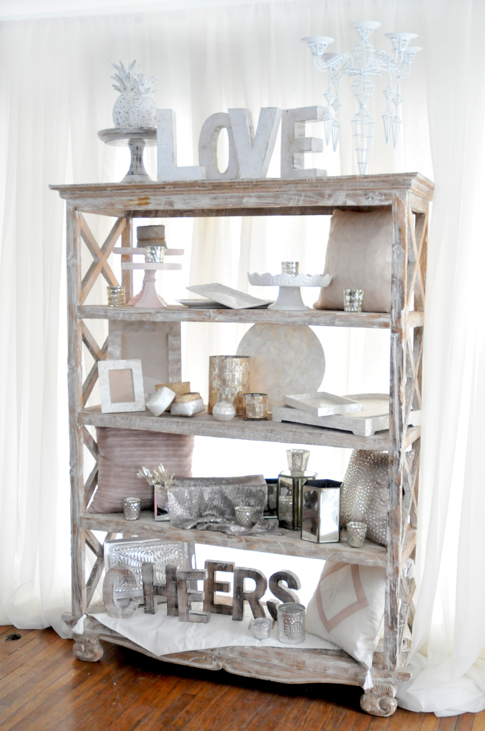 The Coast Bookcase with a distressed white-wash finish is perfect as a bar back to be filled with glassware and liquor. It can also be used for a modern take on a Sweet Table, for Seating Cards or to display family photographs. Let your imagination run wild with this versatile piece.