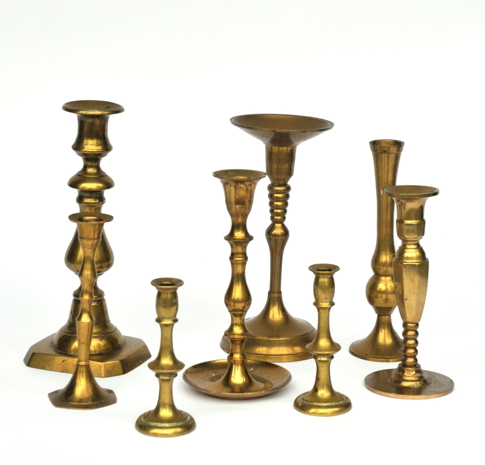 This thoughtfully curated collection of assorted vintage brass candlesticks are a lovely compliment to our Vintage Brass Charger Plates. Consider enclosing them in glass for a safe and modern look.