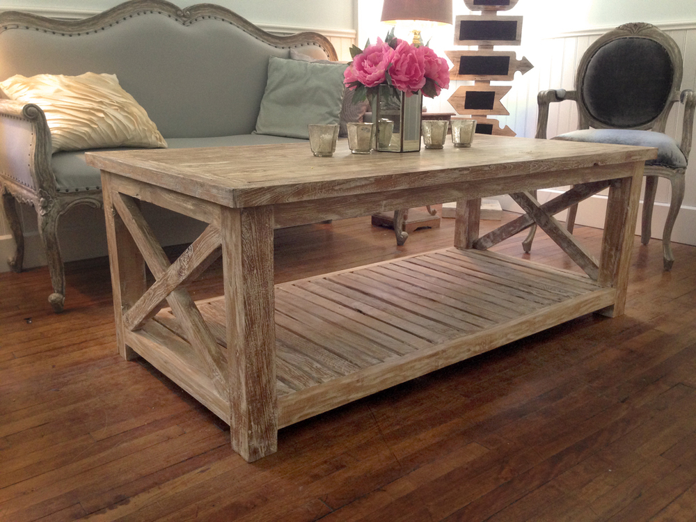 Made from the wood of vintage boats, with a distressed white wash finish, this coffee table has a rustic yet contemporary appeal.