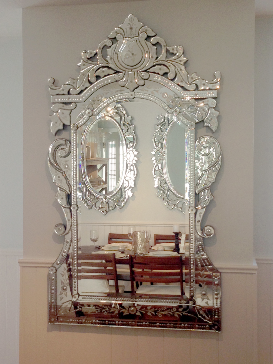 This rectangular Venetian mirror adds effortless glamour to any wedding design. It can be used to reflect and enhance a single chandelier for a Head Table backdrop, as a seating chart or to add sophistication to an outdoor washroom vanity at tented weddings.