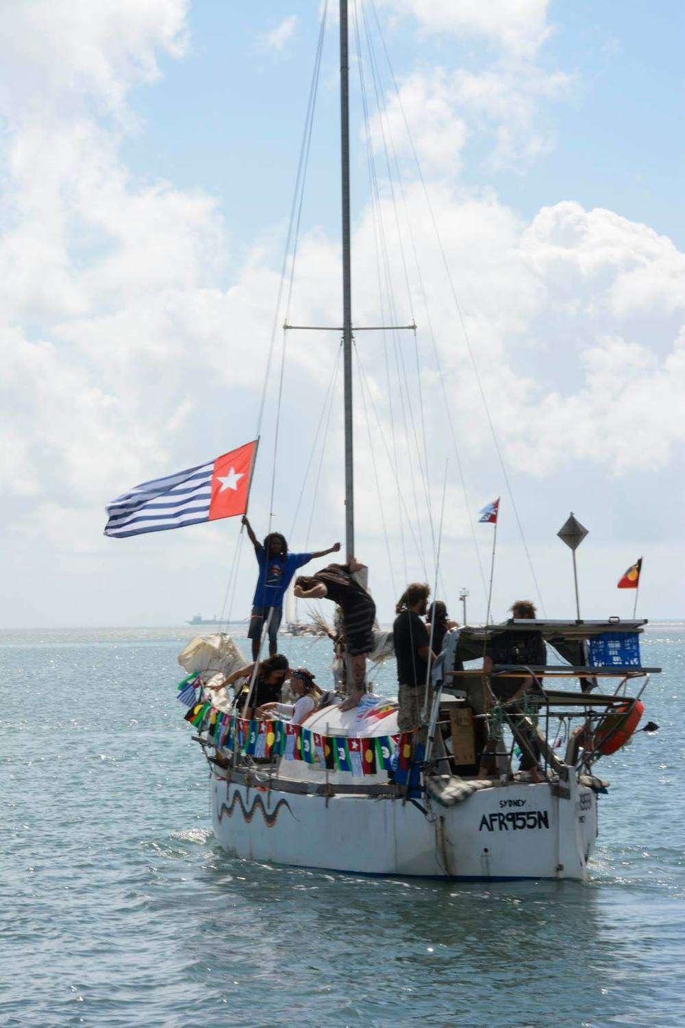 small West Papuan Boat floating off.jpg