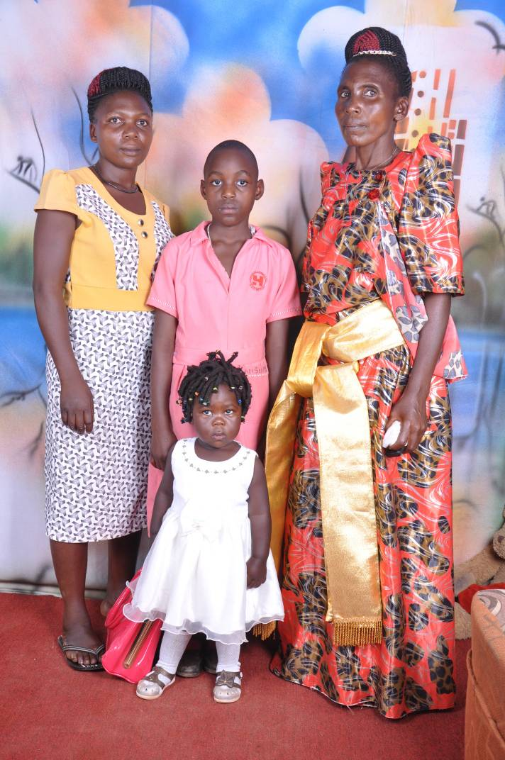 Namuddu (in pink dress) with some of her family members.