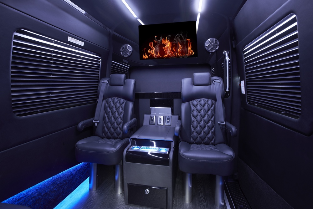 Grech Motors Sprinter shuttle Premier seating captain's chairs with center console cooler