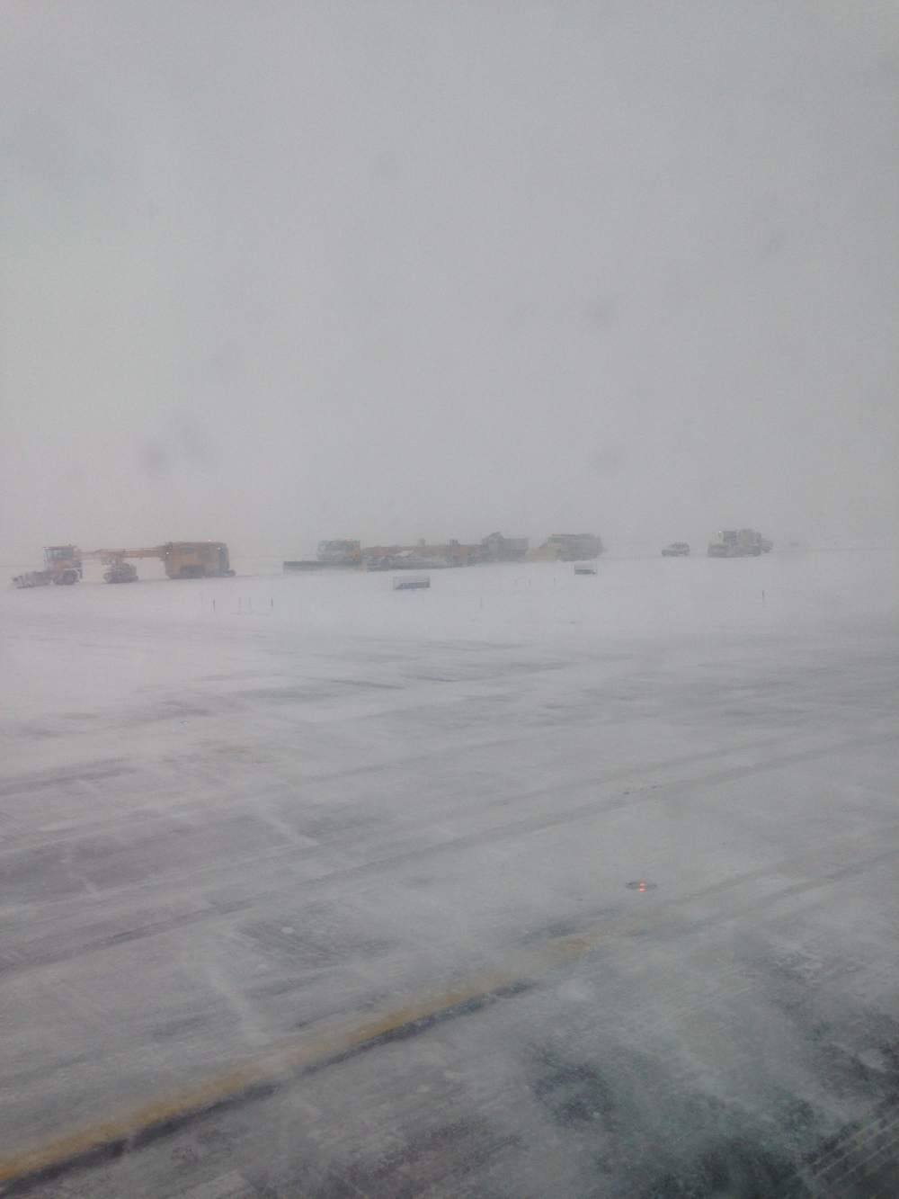 The (in)visibility on the JFK runway, Thursday at 2:30 PM, as seen from the airplane window.