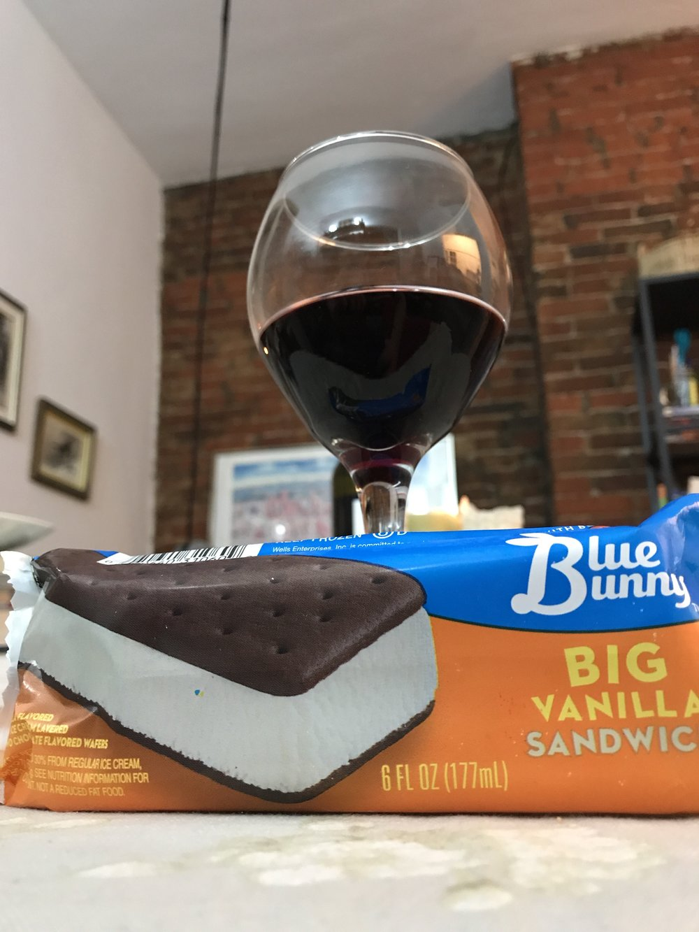 """Came home from a long day to hot dogs, wine, and an ice cream sandwich."""