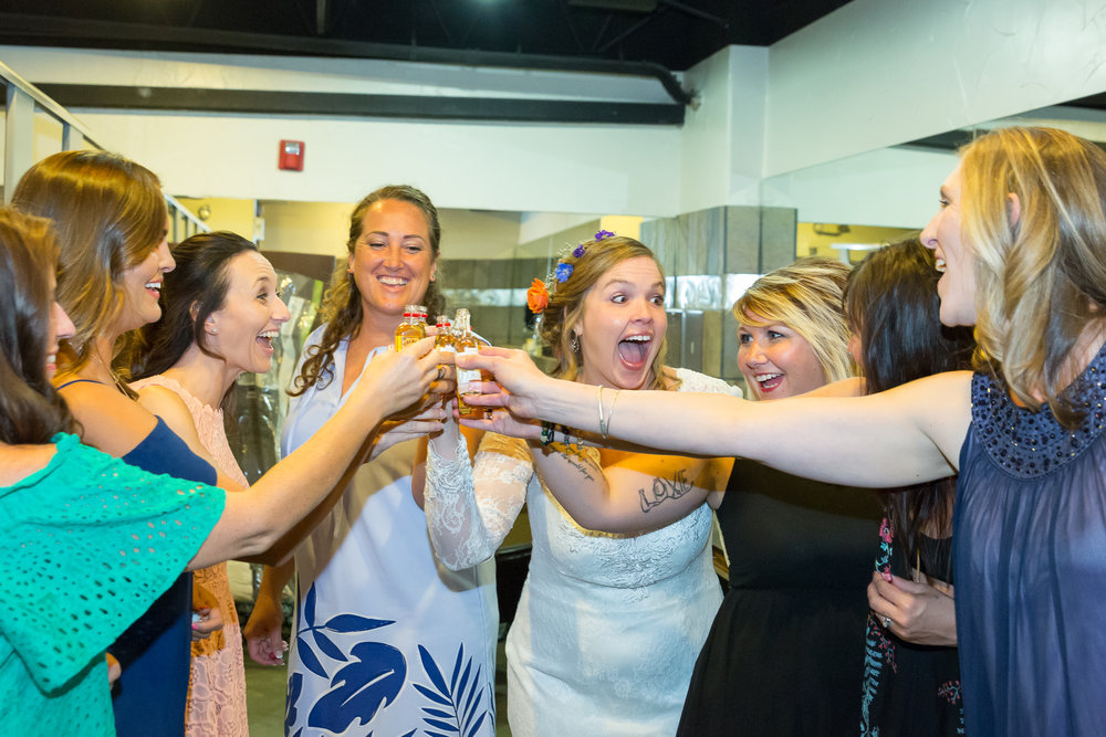 Bridesmaids laugh and celebrate before wedding in Denver, Colorado.