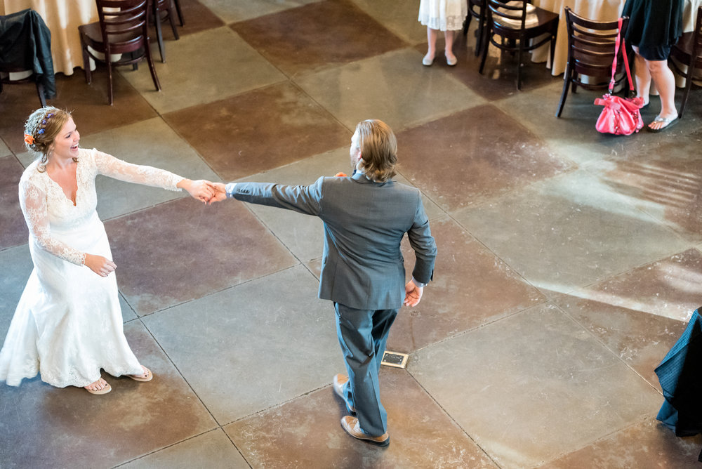 Bride and groom share first dance during wedding at Mile High Station in Denver, Colorado