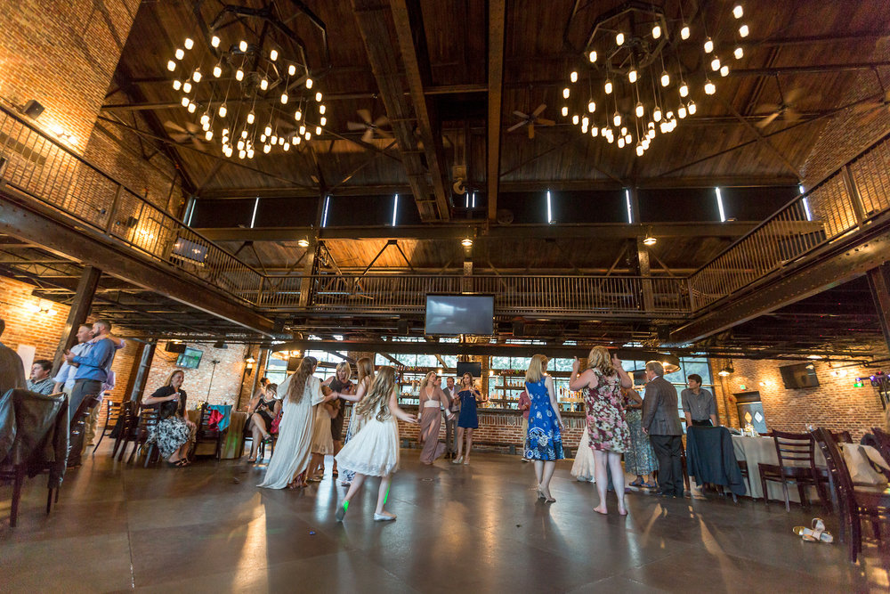 Guests dance at a wedding at Mile High Station in Denver, Colorado